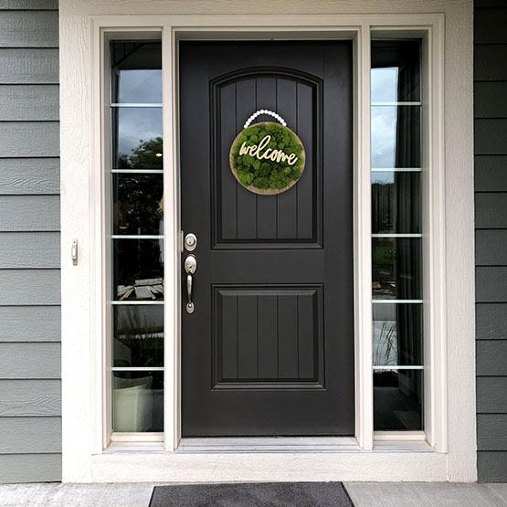 Moss Plaque on front door